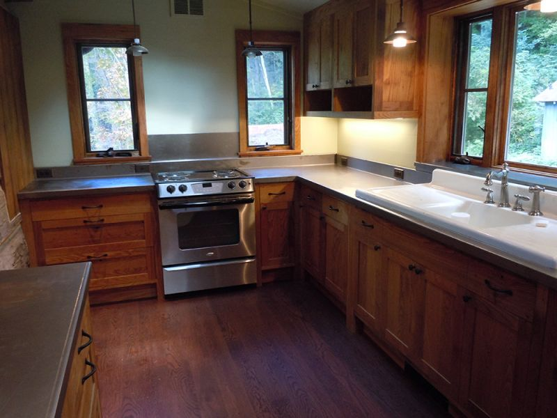 Reclaimed wormy chestnut cabinets for Chestnut kitchen cabinets